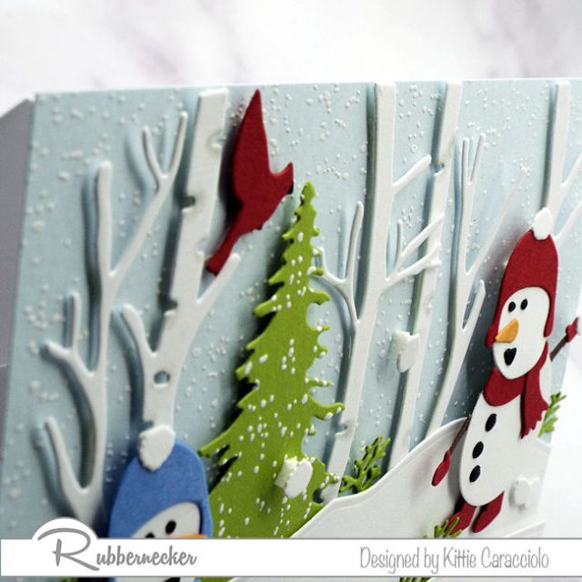 An up close look at how foam tape was used to add motion and depth to one of my snowman card ideas
