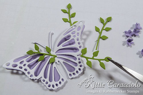 Use small foliage stems and flowers to decorate die cut butterfly embellishments.