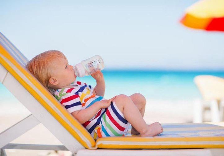 baby-on-sunbed-drinking-water