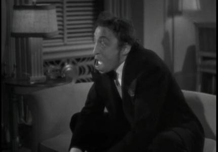 Carlo (Mischa Auer) attempts to cheer up Irene...