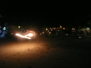 Fire dancer on the beach along the strip of bars