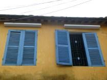 Blue shutters on Hoi An yellow