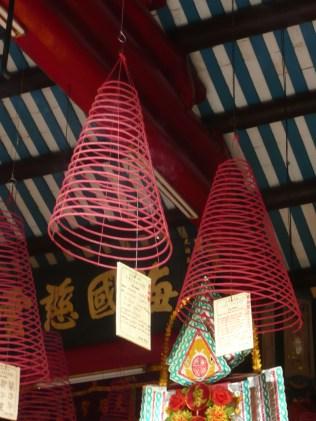 Burning incense coils