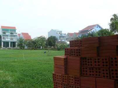Terracotta bricks along a field