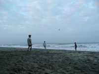 Locals playing foot volley in the sand