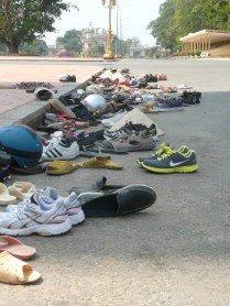 Piles of shoes outside the temple