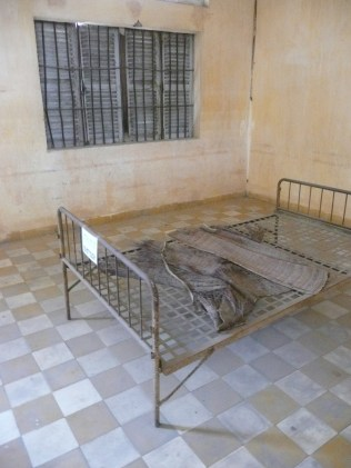 Jail cell at S-21 before transport to the Killing Fields