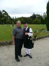 Dad with the bagpipe player