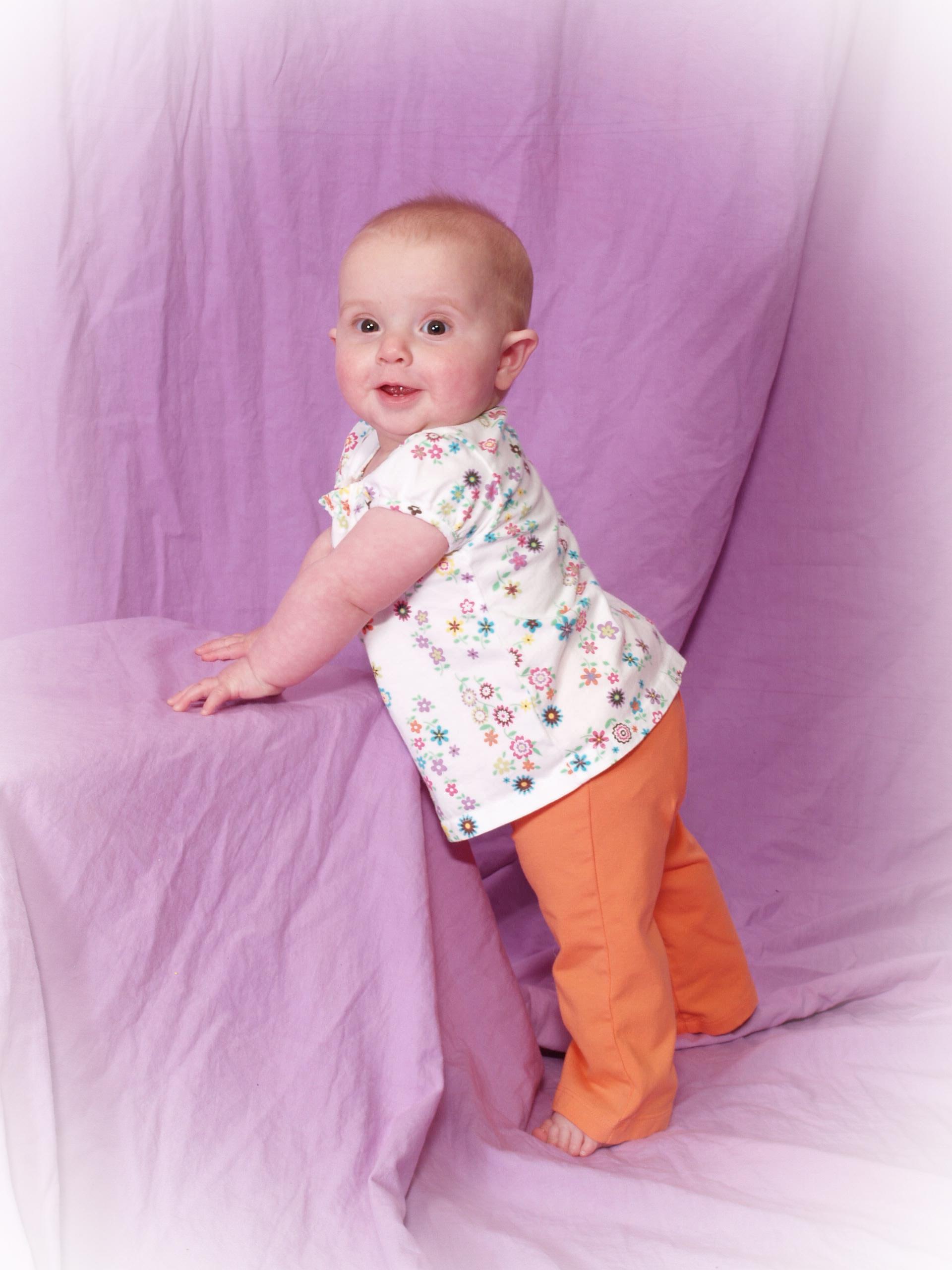kivrin-standing-in-orange-pants