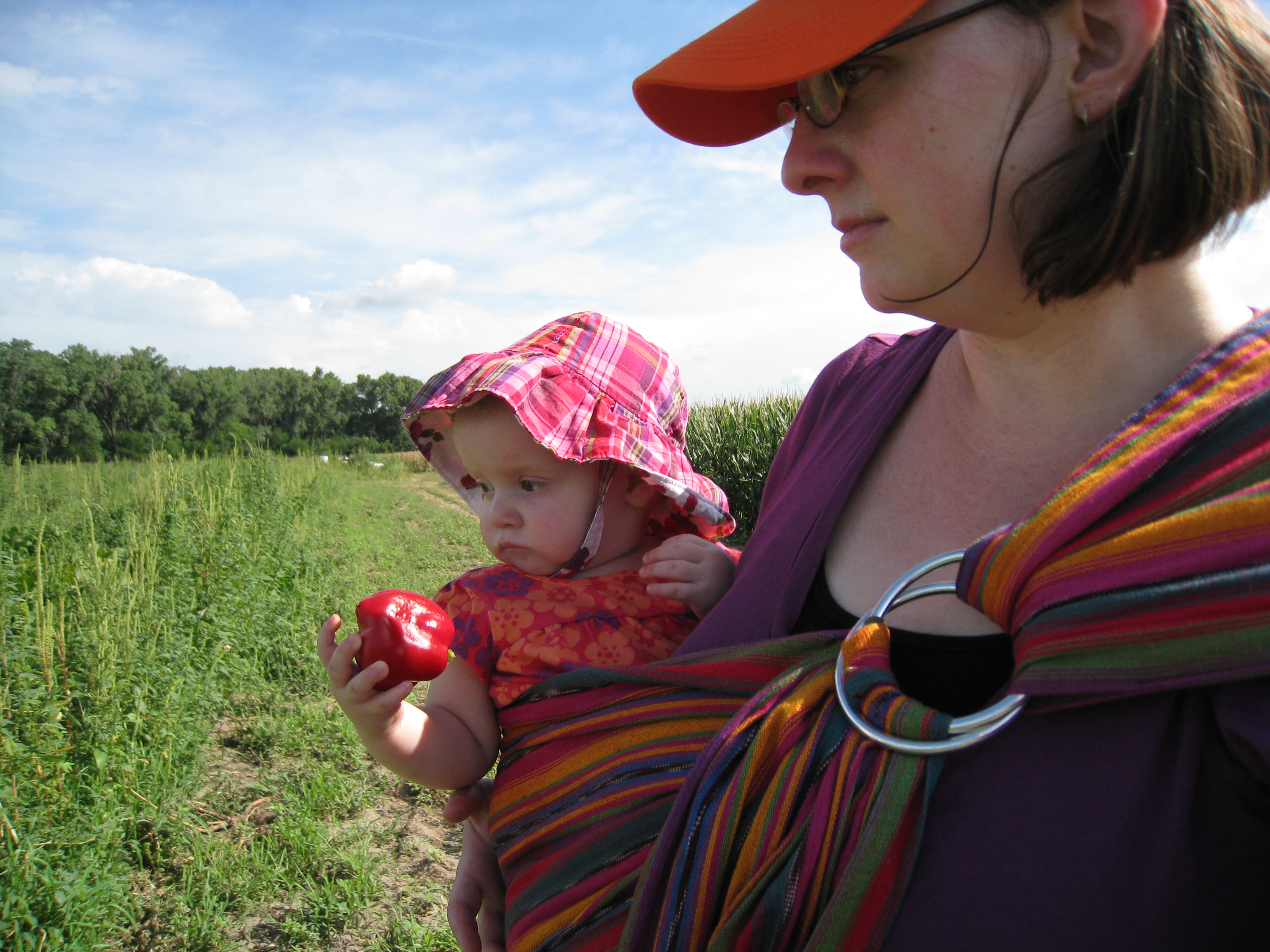 hot and sweaty mama and baby in the field