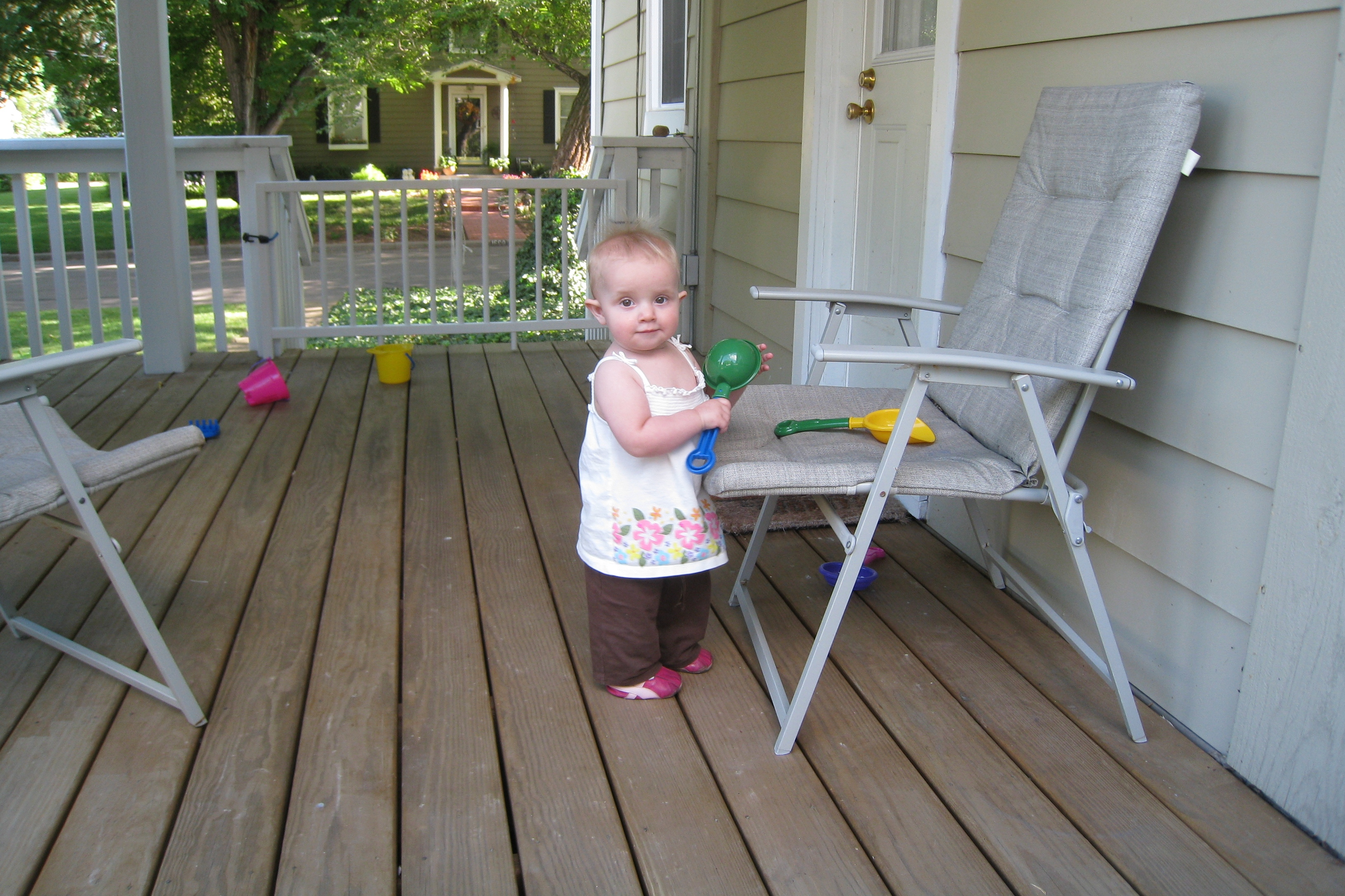 kivrin playing on the porch