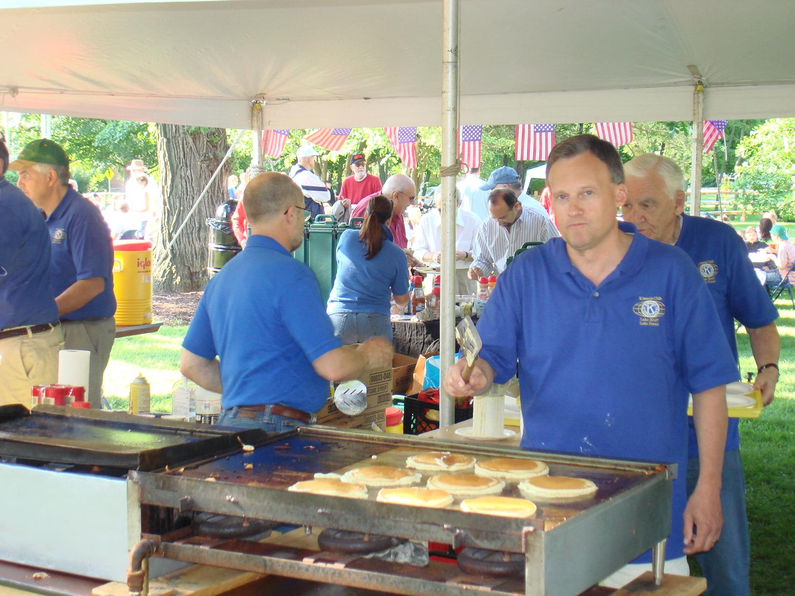 Jim Gillen flipping pancakes.
