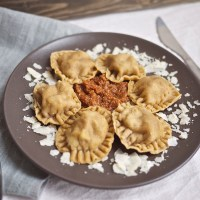 Sage, Lamb, and Ricotta Ravioli with Sun Dried Tomato Pesto