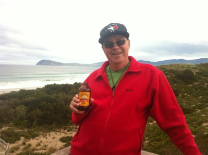 Enjoying a bundaberg ginger beer with the cape we climbed to the top of in the background