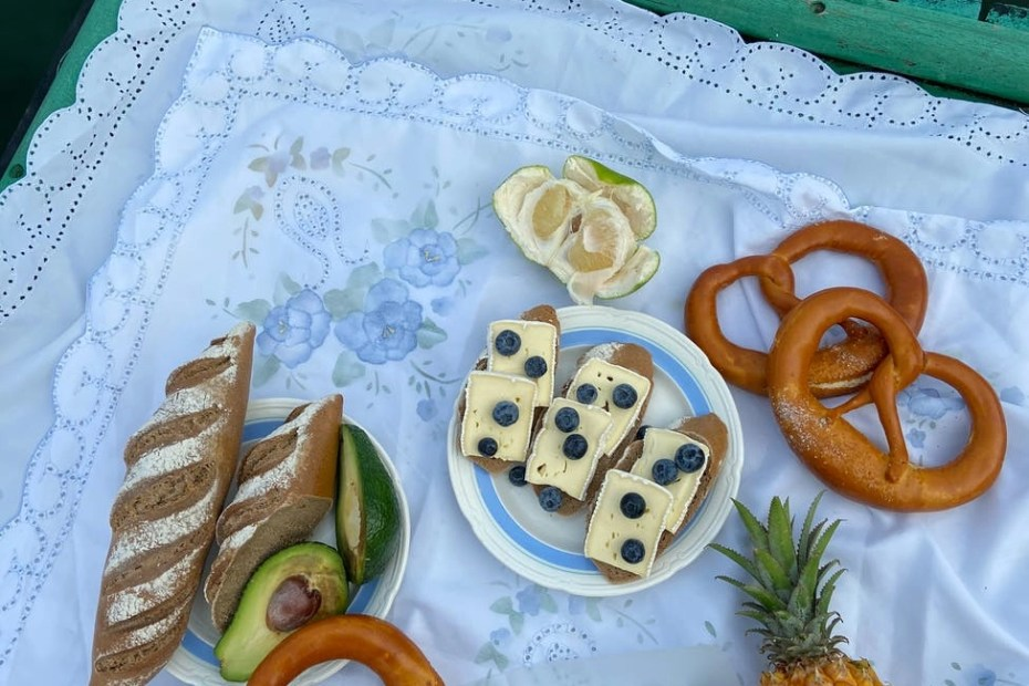 delicious baked food and fruits on blanket