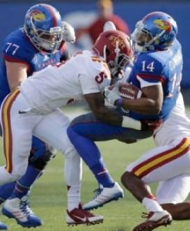 Kamari Cotton-Moya (5) tackles Michael Cummings (14) (Orlin Wagner - The Associated Press)