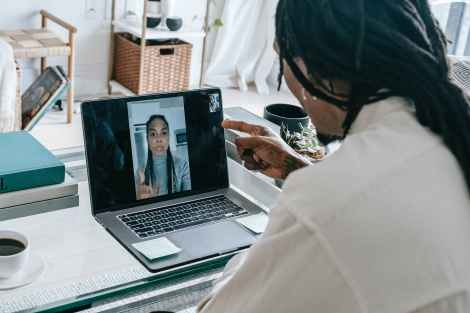 stressed black couple having video call via laptop