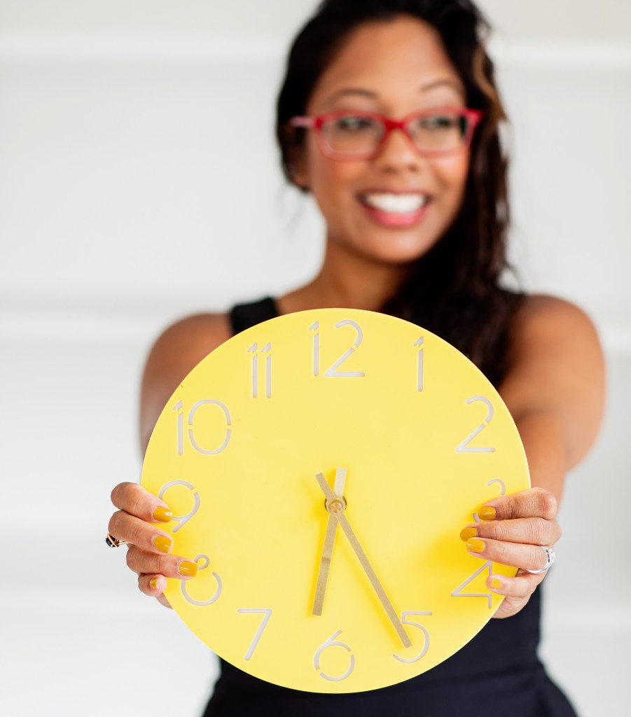 kim keith holding a clock