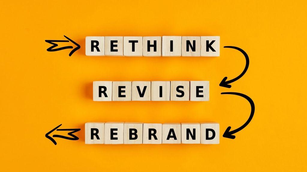 scrabble tiles spelling out rethink revise rebrand