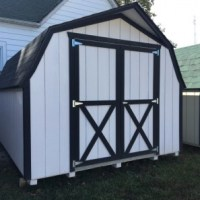 10x12 short wall barn, white w/ black trim, black shingled roof