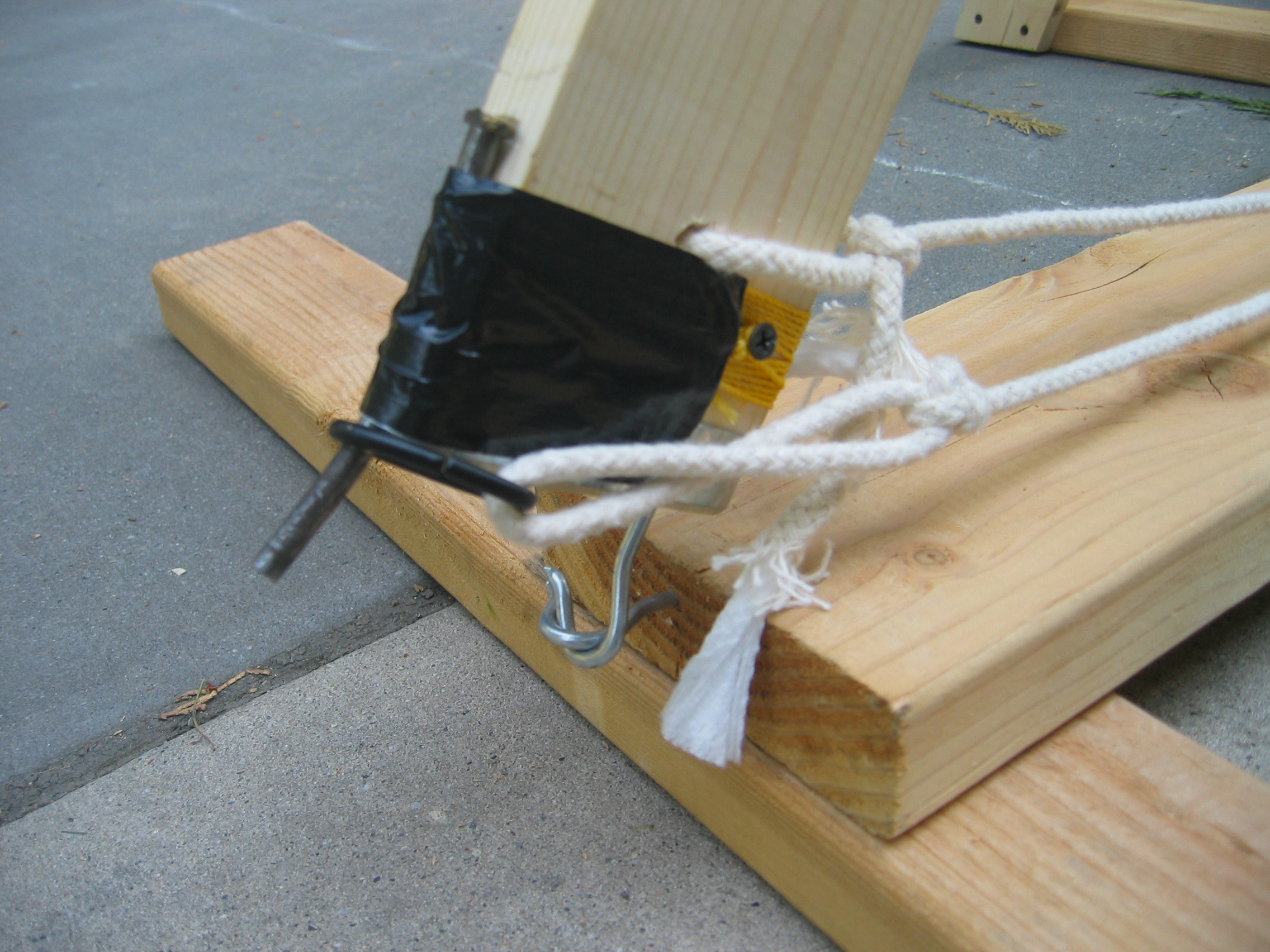 Throwing arm & sling release mechanisms