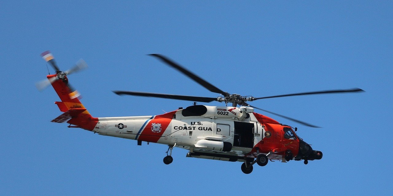 Coast Guard rescues two people and a dog off the coast of Seaside (video)