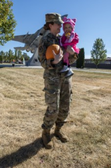 """U.S. Air Force Staff. Sgt. Penny Snoozy with the 173rd Fighter Wing Command Support Staff and her daughter pose for a quick photo during this year's Family Day """"Trunk or Treat"""" drive-in event at Kingsley Field in Klamath Falls, Oregon, October 18, 2020. Kingsley Family Day is an annual event for Airmen and their families to come together and enjoy events on the base. (U.S. Air National Guard photo by Tech. Sgt. Jason van Mourik)"""