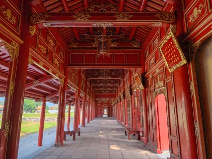 The red hallways of Can Thanh Palace