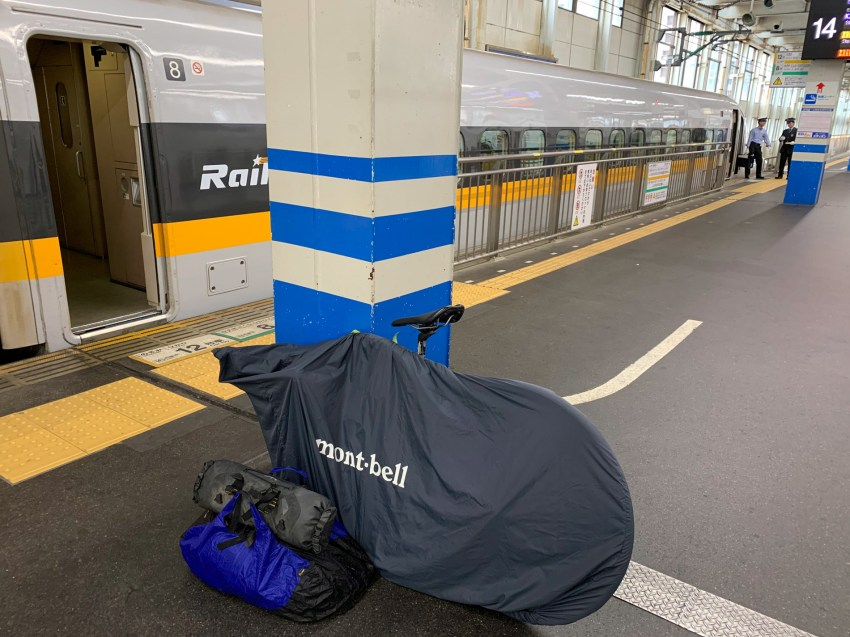 Traveling with my bike on the Shinkansen train, using a rinko bag to cover it.