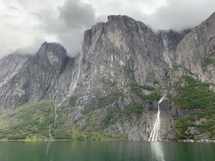 Dramatic rock faces on both sides along the Lysefjord