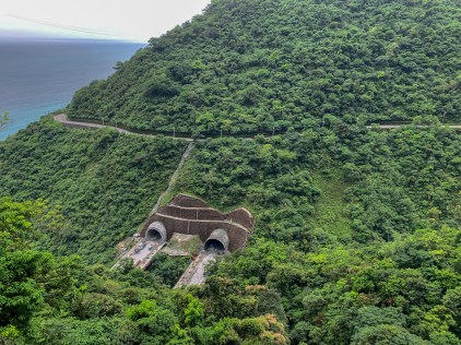 The winding Su'ao Highway, twisting and turning along the eastern shore, being replaced by a more direct route through the mountains using tunnels.