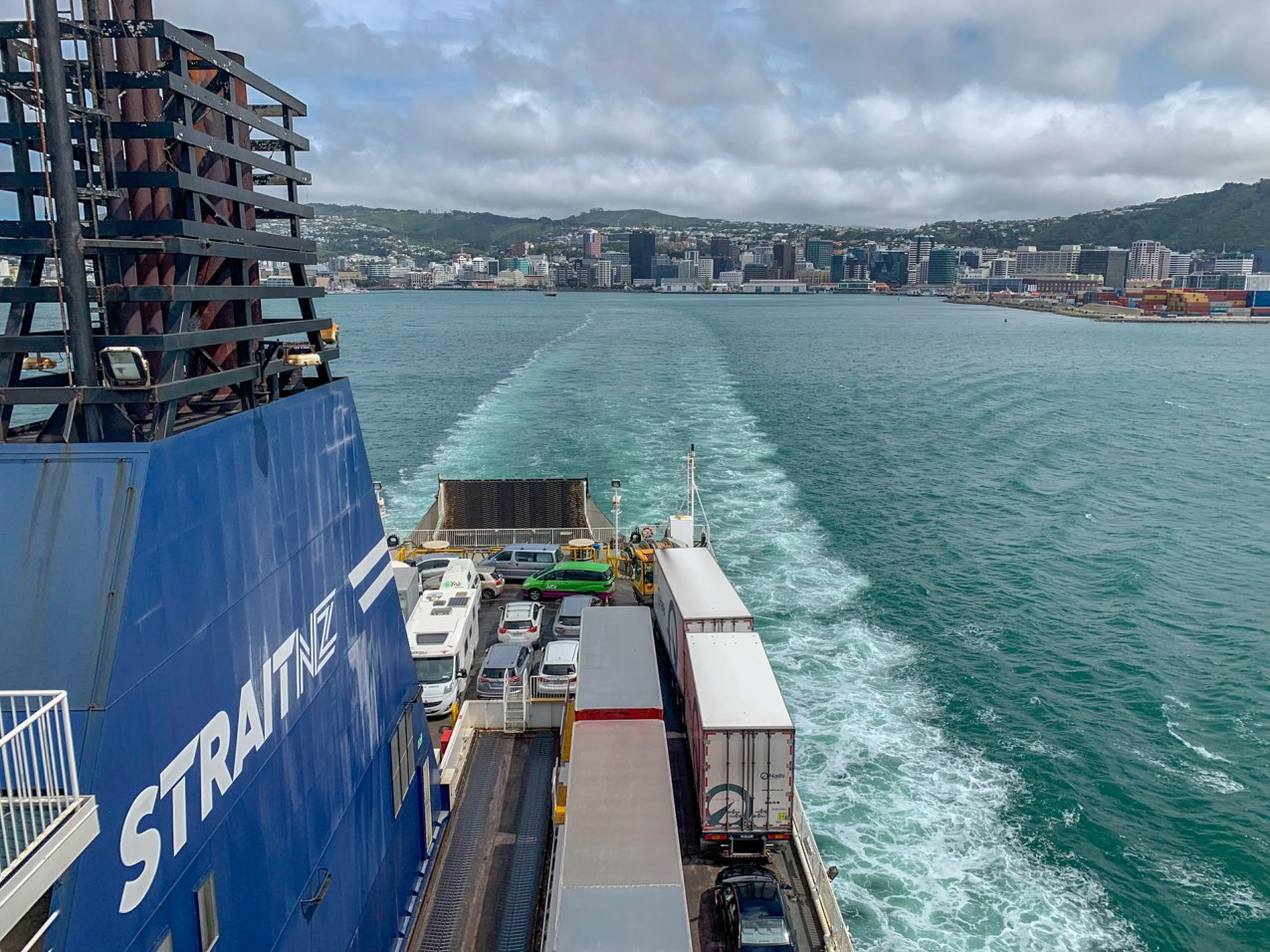 On board the Interislander Ferry, looking towards the stern of the ship. Downtown Wellington is visible in the distance.