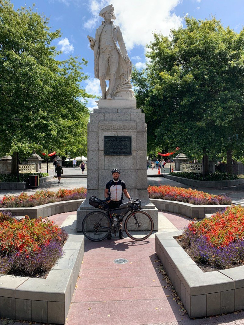 Standing in front of marble statue of James Cook, at the finish of my Bikepacking New Zealand adventure