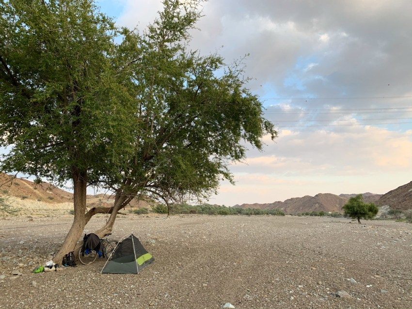 Finding yet another camp spot in a dry riverbed, close to a roadside mosque, with clean drinking water and bathrooms