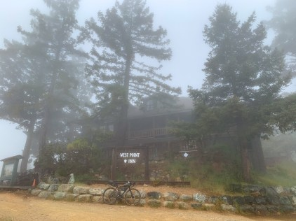 First break at West Point Inn, covered in layers of mist and fog.