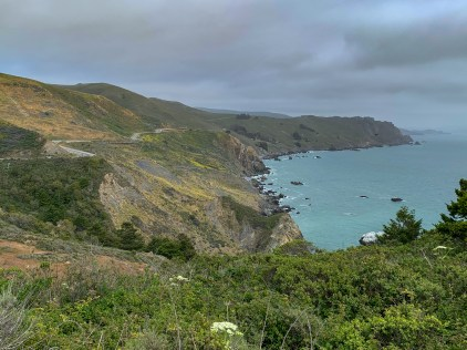 Riding along infamous Highway 1 with views of the Pacific Ocean on the right.