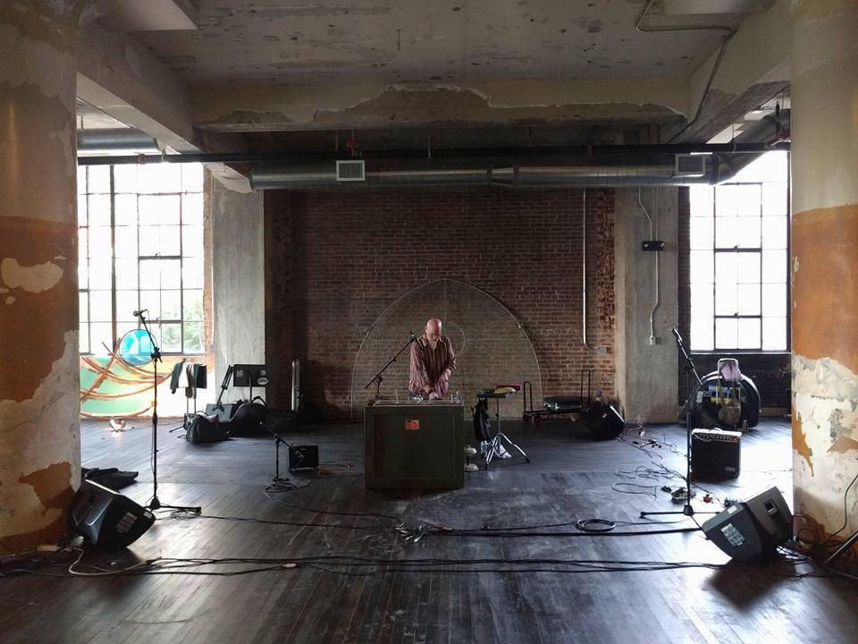 Klimchak sound check at LBC silent auction. Photo by Peter Sloan.