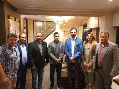 overseas advisor Zulfi Bukhari in London