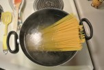 Once your water is boiling pour the raw pasta noodles into the water. Leaving the noodles whole will give you that long noodle romantic effect.