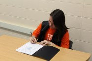 Julie Zabik signs her commitment to play with the K-College women's soccer team. She's been a part of the Loy Norrix women's soccer varsity team since her freshman year. Photo Cred / Caitlin Commissaris