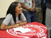 Tizhane Mitchell signs to Olivet College. She will continue her basketball career. Photo Credit / Caitlin Commissaris