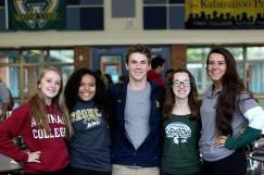 """WEDNESDAY: Seniors Maeve Wilson, Brittany Day, Brendan Feenstra, Sophie Nielson, and Hana Lee dressed in college gear. """"I got my hoodie from Aquinas last year when I visited, the campus was really pretty,"""" said Wilson. Photo Credit / Hannah Pittman"""
