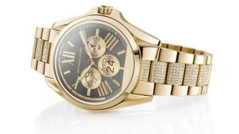Reloj Michael Kors en color dorado con pequeños diamantes en las correas y el dial negro