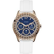 Reloj Guess con correas blancas, caratula dorada y dial en azul marino