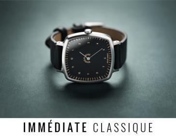Reloj clásico negro con decorados en café