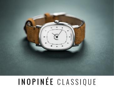 Reloj clásico con blanco y decorados en negro