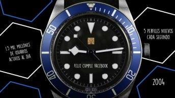 """Reloj negro con azul con leyenda de """"Feliz cumple Facebook"""""""