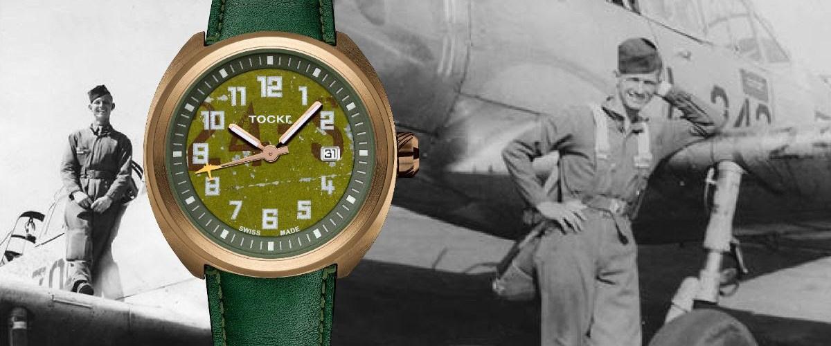 Reloj Tockr con correas verdes con carátula en color dorado con detalles en verde y blanco y a los lados la imagen de un hombre