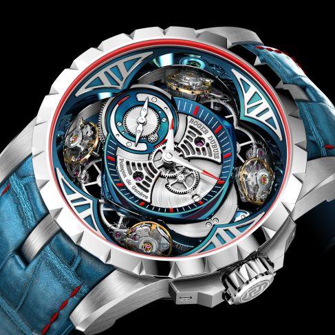 Reloj con correas azules y caratula en color plateado con detalles en azul y rojo