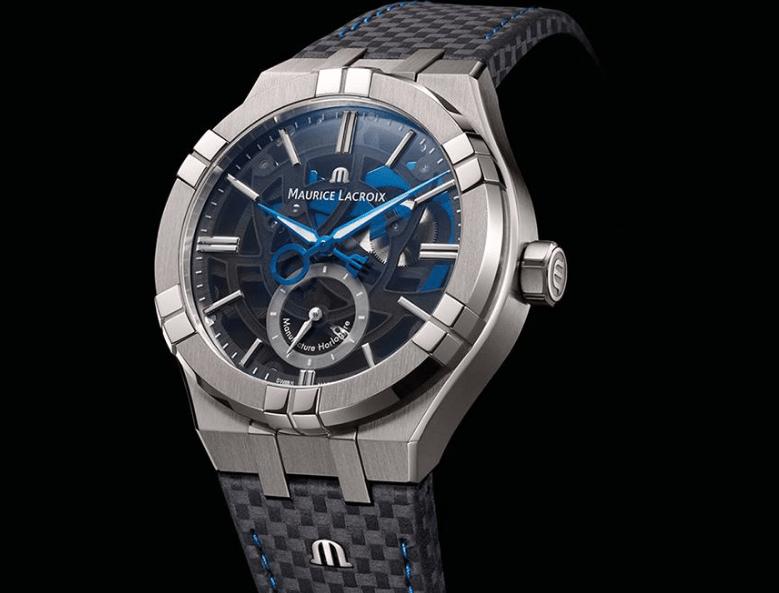 Reloj Aikon Mercury en color plateado con detalles en negro y azul